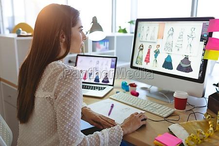female fashion designer working on computer
