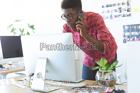 graphic designer talking on mobile phone