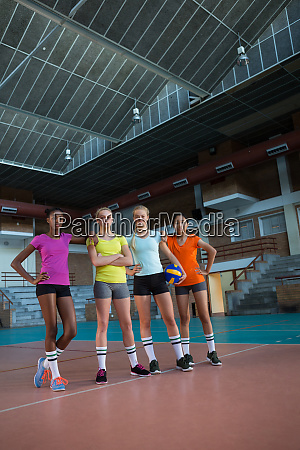 smiling female players standing together in