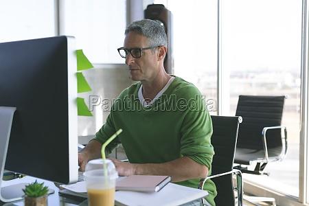 businessman working on computer at desk
