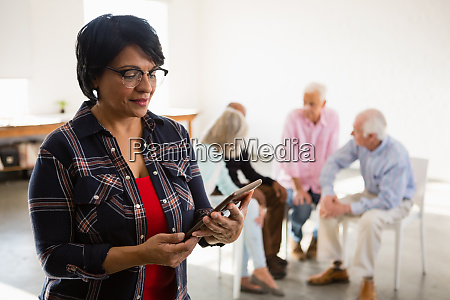 senior woman using digital tablet with