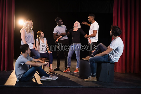 actors practicing play on stage