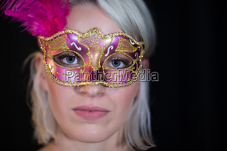 woman wearing masquerade mask