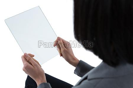 female executive using a glass digital