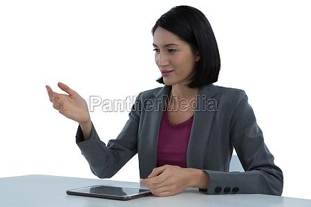 businesswoman gesturing at desk