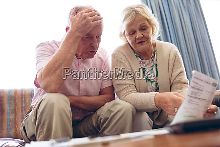 senior couple discussing over medical bill