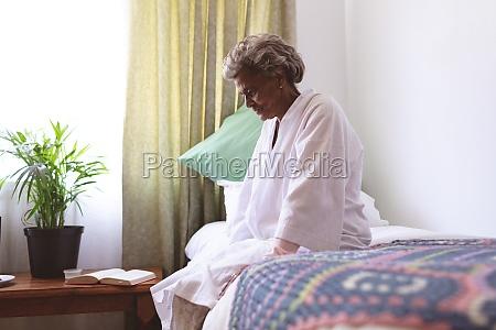 senior woman sitting upset in nursing