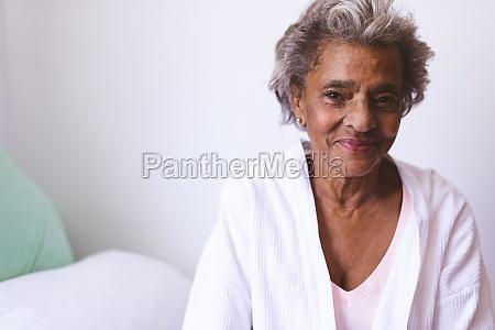 happy senior woman smiling while sitting