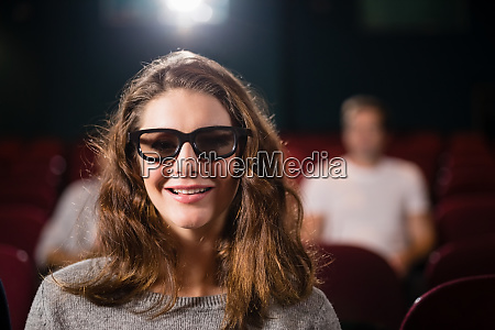 woman watching movie in theatre