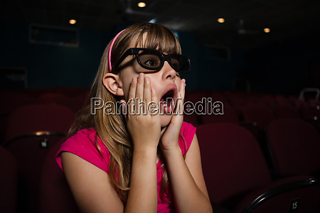surprised girl wearing 3d glasses while