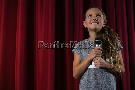 girl holding microphone on stage