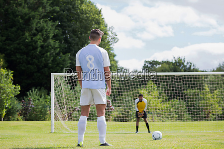 soccer player is ready to kick