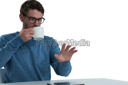 man pretending to use an invisible