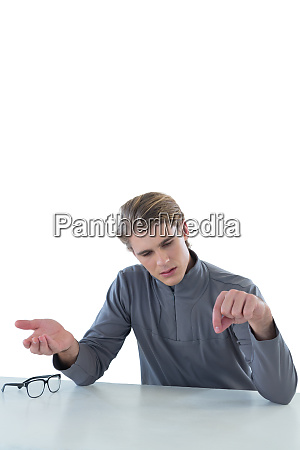 young businessman examining invisible product