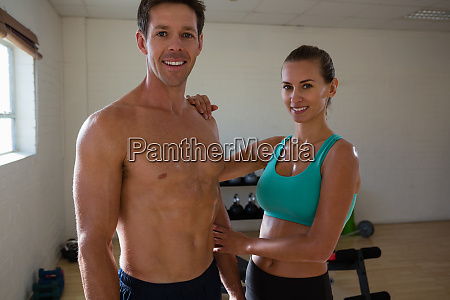 portrait of athletes standing in fitness