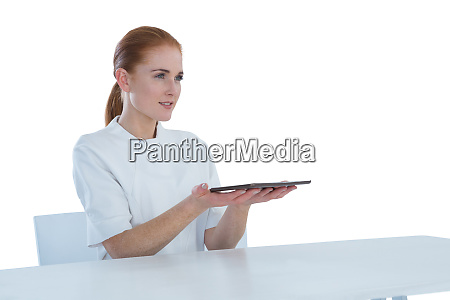 smiling businesswoman holding tablet computer