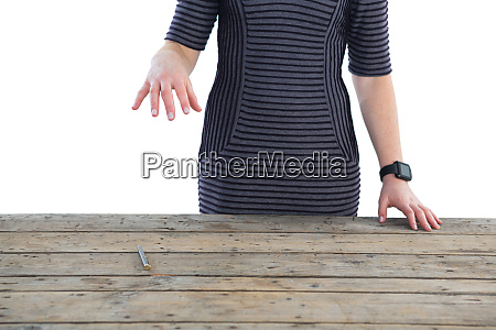 mid section of businesswoman holding invisible