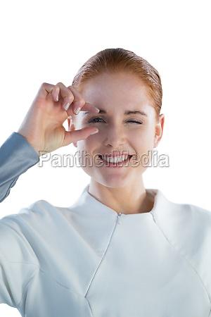 portrait of smiling woman adjusting imaginary