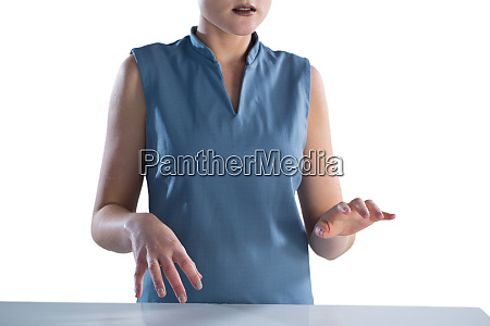mid section of businesswoman using imaginary