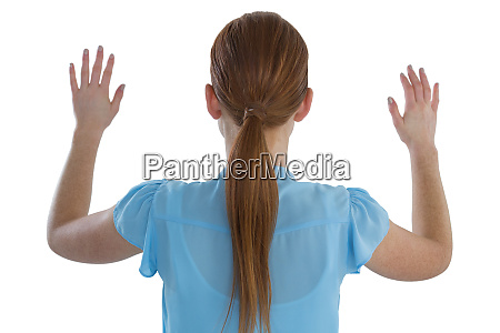rear view of businesswoman using imaginary