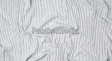 fragment of gray knitted fabric full