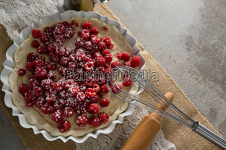 red berries on tart with whisker