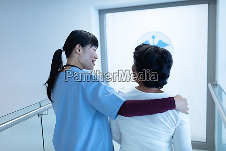 female doctor interacting with female patient