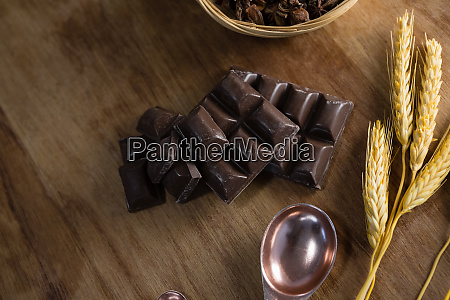chocolates and wheat ear on wooden