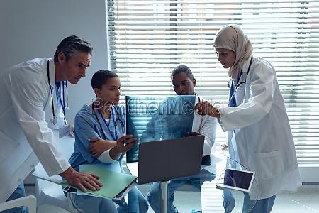 medical teams looking at x ray