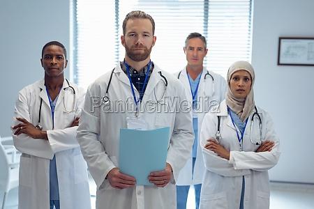 medical team standing together in hospital