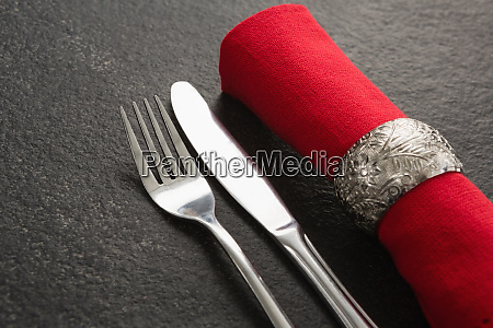 fork and butter knife and napkin