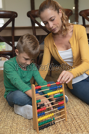 mother teaching her son mathematics with