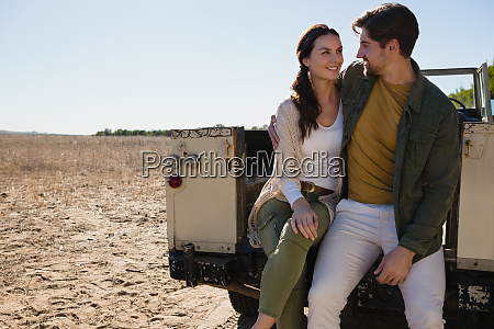 romantic couple sitting in off road