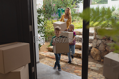 mother and children with cardboard boxes