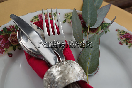 cutlery with napkin and leaf in