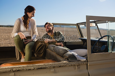 couple relaxing in off road vehicle