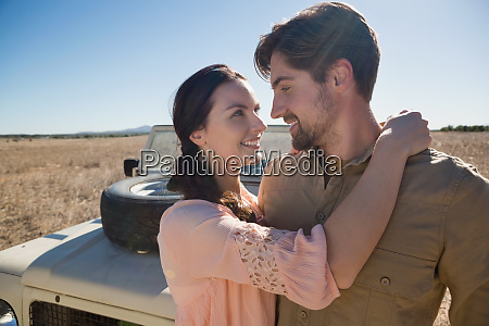 romantic couple by off road vehicle