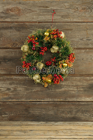 christmas wreath against wooden background