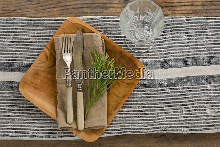 flora and cutlery arranged on plate