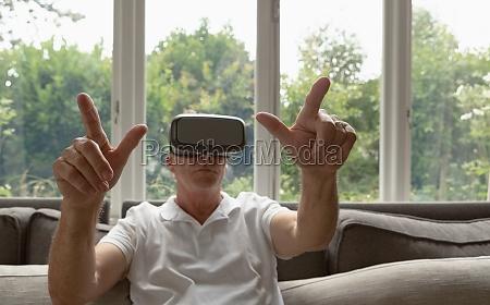 active senior man using virtual reality