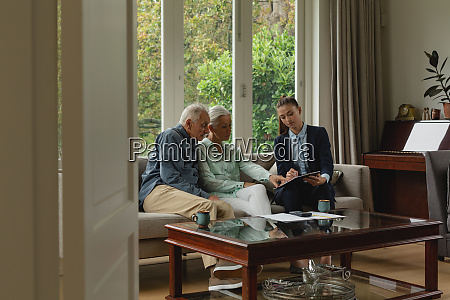 active senior couple discussing with real