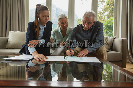 active senior couple signing an agreement