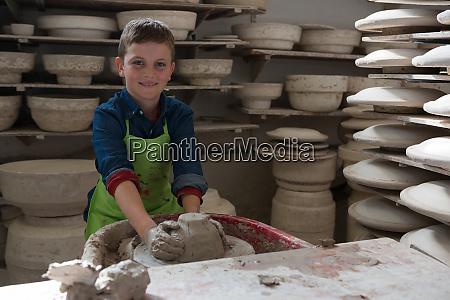 boy making a pot in pottery