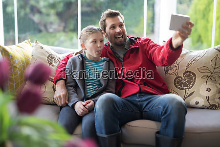 father and daughter taking a selfie
