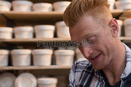male potter working in pottery workshop