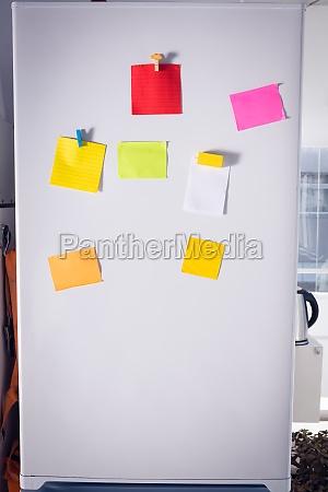 sticky notes on refrigerator