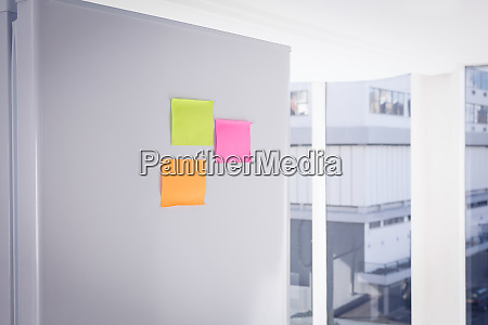 adhesive notes on refrigerator
