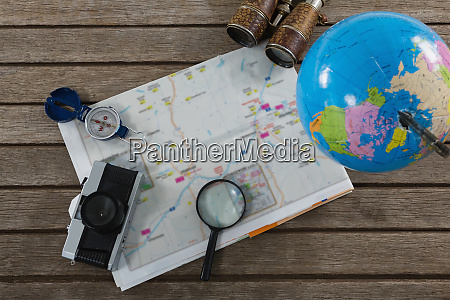 travelling accessories on wooden plank