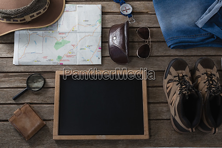 apparels and travelling accessories on wooden