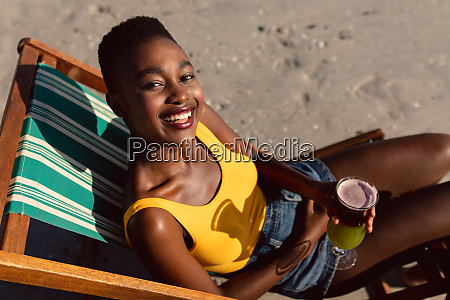 woman with cocktail glass relaxing in